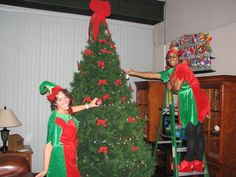 Elf Kelli & Elf Danielle worked hard to decorate the tree at the Georgia Visitor Information Center in #Savannah #Georgia (on I-95).