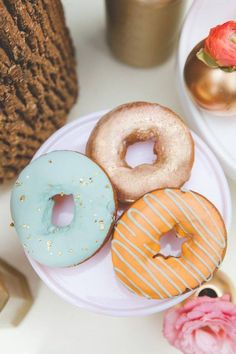 tiffany blue donut with gold flakes.