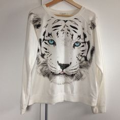 Snow tiger pull over sweatshirt Snow tiger with piercing ice blue eyes printed pull over sweatshirt. Crew neck, long sleeve. Fits more like a medium. Forever 21 Sweaters Crew & Scoop Necks