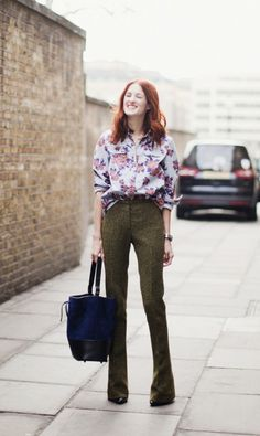 Taylor Tomasi Hill in floral blouse and wide legs
