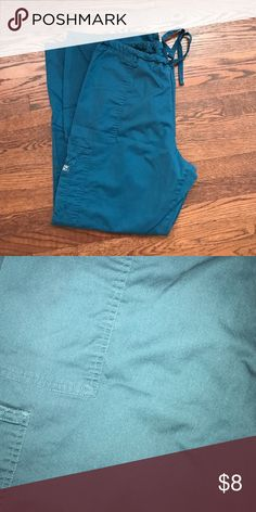 ⚡️FLASH SALE⚡️Cherokee scrubs Gently used. Size XL Cherokee workwear women's scrub pants. Color is Caribbean blue. Drawstring waist, flare pants with 2 hand pockets a cargo pocket on right leg. Very minor piling to legs. Still tons of life left!  No rips or stains. Cherokee Pants