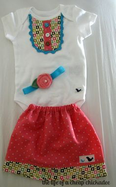 bib front onesie. this site has tons of handmade onesie and baby gift ideas