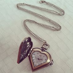 Check out this item in my Etsy shop https://www.etsy.com/listing/180058031/heart-locket-clock-necklace