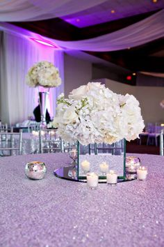 White, wedding floral centerpiece. M. Elizabeth Events