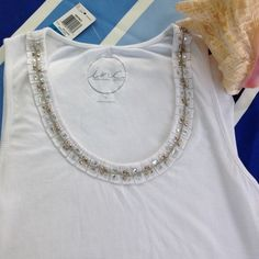 INC White Beaded Tank Top NEW with Tags, Cute white beaded tank top, ribbed material. Looks like a line in material, very light barely noticeable. Shown in photo. INC International Concepts Tops Tank Tops