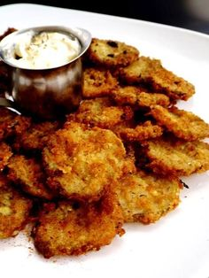 Frying Up Some Pickles!  This recipe for fried dill pickle chips calls for a buttermilk Béchamel, a double coating and a mixture of crumbs and flour for light crunch. Served with along side is a simple dipping sauce of i part mayo and 1 part ranch dressing with some celery salt on top. Classic pub food, I have to admit, has been making for great party food lately and it's easy to see why frickles have attained cult status.