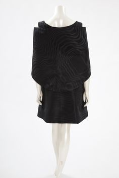 """Balenciaga Haute Couture Moiré Cocktail Dress, Spring-Summer 1963  This lovely haute couture watered (moiré) silk taffeta dinner/cocktail dress is the ideal """"Little Black Dress"""" for any perfect modern wardrobe. Labelled and numbered 84543, the dress features a fabric-matched stole. Boat neckline. Flattering silhouette with a high waist in the front, lower gathering at the back (see picture 5). The skirt flares out over the hips, accentuating the waist. Fully lined in silk chiffon, the…"""