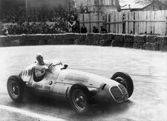 """The racecar driver Juan FANGIO in a curve called 'de la Gare' during the automobile Grand Prix de Pau"" : uan Manuel Fangio - Maserati 4CLT/48 - Scuderia Achille Varzi - XI Grand Prix Automobile de Pau 1950 - Non championship Formula 1 race - © Getty Images"