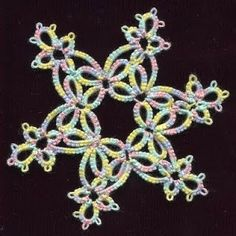 4 Ring Snowflake - TATTING by Wendy's Crafty Hands. ***I don't know if this is Needle or Shuttle.***