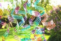 Recycle used water bottles into colourful wind spirals.