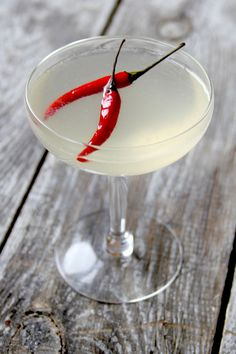 The Killer B  1 1⁄2 oz. London dry gin, such as Beefeater 3⁄4 oz. lemon juice 3⁄4 oz. Thai chile simple syrup Red Thai bird chiles, for garnish
