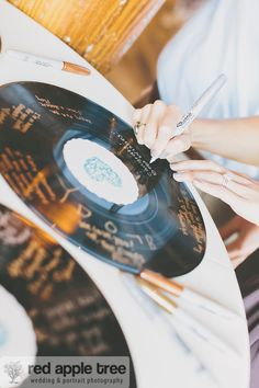 red apple tree photography: Rock & Roll for this bride and groom, Katy + Jamie Wedding, vinyl records