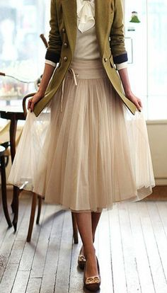 Adore this whole outfit, the contrast of the ballet style skirt with the military jacket is a wonderful and highly effective look.
