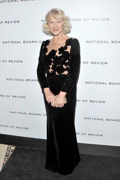 Dame Helen Mirren in our floor length velvet dress with hand sewn laser cut flowers on nude tulle bodice.