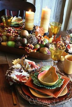 Mixture of all things fall tablescape!!! Bebe'!!! Mix of fall berries, wooden bowls, fall leaves, and fall colored china and pottery!!! Great fall tablescape....from blog.styleestate.com!!!