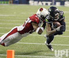 Seattle Seahawks wide receiver Paul Richardson (10) is knocked out of bounds on the six yard line by Arizona Cardinals cornerback Brandon…