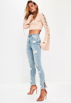Denim never dies! Add these timeless skinny jeans to your wardrobe - featuring a light vintage blue hue, highwaisted style, distressed denim and side split details.    I am distressed, so over time I will become more ripped and worn, but th...