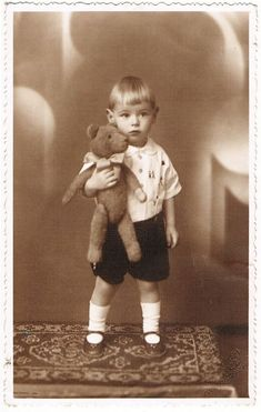 Vintage photo of little boy with Teddy bear.