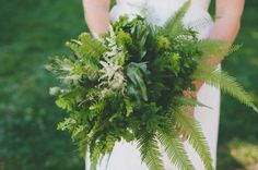 We love this fern bouquet! So many different variety of ferns and leaves, punctuated by some white astilbe flowers and poppy flower pods. It's perfect for a rustic or woodland-style wedding.