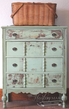 a simple piece of trim added to dresser drawers would give it this vintage look - how pretty!
