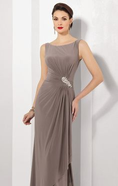 Punctuate your personality with elegance and style in Cameron Blake 216690. This long gown offers a boat neckline with low V-back. Soft jersey gathers along the waist leading the layered side draped skirt, with ornate beads add cluster of glittering allure. Matching shawl included.