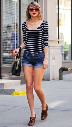 APRIL 12, 2014 Swift embraced warmer weather in a a striped top, cuffed Hudson denim shorts, statement red shades, and her favorite shoe type: Oxford heels.