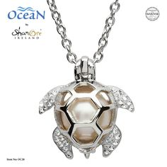 A solitary pearl from Swarovski® is housed in a sterling silver turtle shell cage. The leg and tail extensions of the magical turtle pendant are embellished with sparkling white Swarovski crystals. Pearl Pendant Necklace, Pearl Jewelry, Silver Jewelry, Silver Ring, Pearl Necklaces, Pearl Bracelets, Pearl Rings, Geek Jewelry, Gold Jewellery