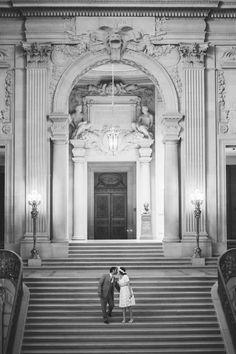 a kiss on the steps of San Francisco City Hall