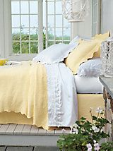Milano Matelasse Coverlet | linensource       Floral duvet cover and colorful blanket at bottom of bed