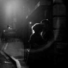 Love at night. Couple kisses