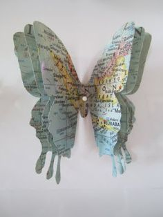 Could do similar idea with art on coloured papers:  Butterfly Art from Vintage Maps