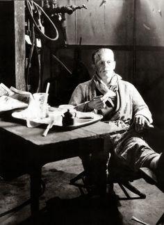 Boris Karloff having tea and sandwiches on the set of 'Bride of Frankenstein' 1935