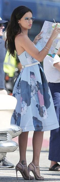 Who made Adriana Lima's blue floral strapless dress?