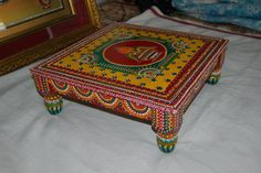 It'll be nice if we could make legs out of old bottles and a skirting like this - a tiny height ed table called (BAJOT). with the kalash shape in center uses for pooja purpose. Desi Wedding Decor, Indian Wedding Decorations, Creative Gift Wrapping, Creative Gifts, Diy Arts And Crafts, Handmade Crafts, Painting Old Chairs, Headband Holders, Thali Decoration Ideas