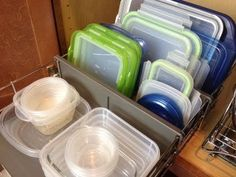 Metal drawer inserts - perfect for taming those pesky containers, tupperware and lids. How To Organize Food Storage Containers And Tupperware Organize Plastic Containers, Kitchen Storage Containers, Kitchen Organization Pantry, Kitchen Storage Solutions, Container Organization, Pantry Storage, Organization Hacks, Organizing Tips, Food Containers