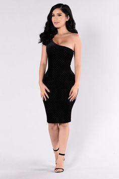- Available in Black - Open Sided Dress - Sleeveless - Ruffle Top - Gold Grommet Design - Velvet - Midi Length - Made in USA - 94% Polyester 6% Spandex