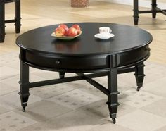 This 3 Piece Occasional Table Set by Coaster includes a coffee table and two end tables. This updated traditional style round coffee table group features casters on the bottom of the coffee table, storage drawers and it is finished in a rich black. Round Black Coffee Table, Coffee Table With Casters, Coffee Table With Drawers, Cool Coffee Tables, Coffee Table Design, Black Table, Coffe Table, Coaster Fine Furniture, Table Furniture