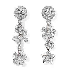 Folie des Prés earrings, white gold, round and marquise-cut pink sapphires, pear-shaped mauve sapphires, round diamonds; diamond quality DEF, IF to VVS. About the collection: To celebrate the natural beauty of wildflowers, Van Cleef & Arpels has created the lively elegant Folie des Prés collection.