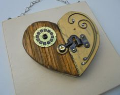 I created this original heart assemblage from new and vintage materials. The canvas is a cupboard door that has been painted and distressed. I cut the heart from barn wood which was also painted and distressed. I found some great new and vintage items in my goody pile to detail with. Some of the items have been purchased from other Etsy shops. The wire at the bottom is hand twisted by me.  This piece measures 13h x 13w x 2d.