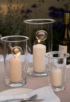 This handmade RHS hurricane lamp has been produced by Dartington Crystal in high quality clear glass featuring a unique hand applied motif of the RHS tree logo