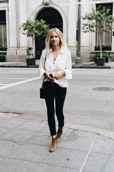 White lace-up shirt, Isabel Marant boots, Céline sunglasses & Céline trio bag. Via Mija