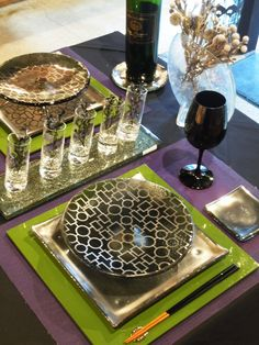 Tabletop design with silver dinnerware set. Silver show plate and matching bread and butter dish, dinner plate with bold geometric design in silver with long serving plate. Luxurious and edgy! By Glass Studio