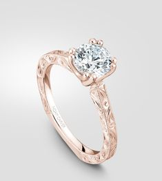 Vintage inspired engagement ring in rose gold with detailed design and a 1carat centrepiece by Noam Carver.
