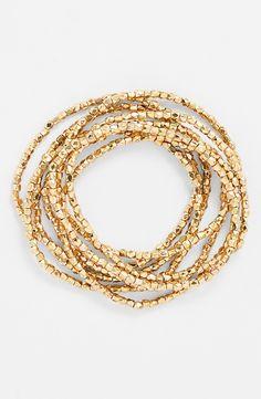 Love layering these metallic stretch bracelets.