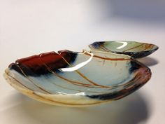 A series of bowls inspired by butterfly wings. Fused glass art.