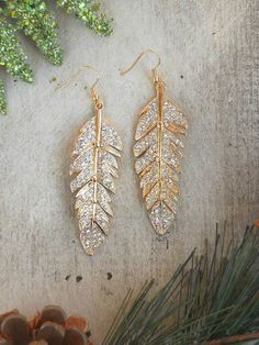 "Golden earrings features stationed sections for movement and sparkle. The right amount of sparkle and perfect for everyday wear. Earrings measure 2"" length. Imported."