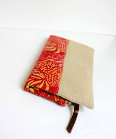 Fold over clutch, Foldover clutch, Poppy Red Bali Batik Beige Handbag, Zippered Wallet Purse Evening clutch This red and beige zipper fold over clutch is perfect for shopping, hanging out with friends, evening out or a short trip to pick up your kid from school :) I fall in love at the first sight with the combination of the fabrics, red Bali batik cotton and natural beige linen. The lining is made from natural linen like the outside. The clutch reinforced with interfacing and double s...