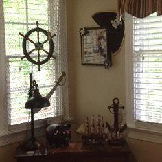 [swords, ships, skulls, dark wood] Pirate room