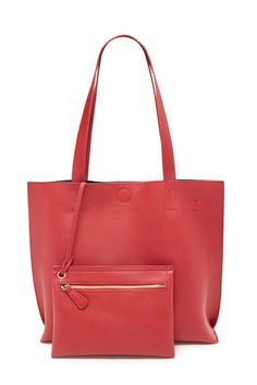 This faux leather tote is complete with dual top handles, a removable and adjustable long strap, a magnetic snap closure, and a removable faux leather clutch with a zippered closure.