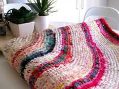 Learn how to make a finely crocheted rag rug with this tutorial from a master rag rugger! Upcycle old fabrics and clothes and produce a colorful creation with this easy circular rug pattern. by ashleyw Fabric Rug, Fabric Scraps, Scrap Fabric, Rag Rug Diy, Circular Rugs, Homemade Rugs, Crochet Rug Patterns, Crochet Rugs, Free Crochet